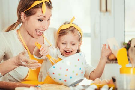 paper pin: Mum and daughter baking cakes in the morning.