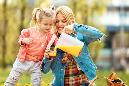 Happy family of two enjoying free time in the park. Stock Photo
