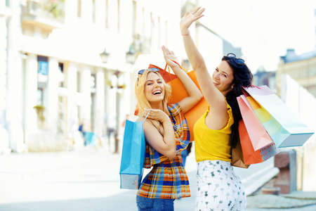 Young and attractive young woman enjoying shopping. Stock Photo