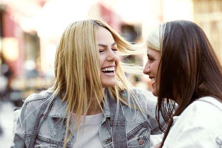 Happy young women having fun in coffee shop. Stock Photo