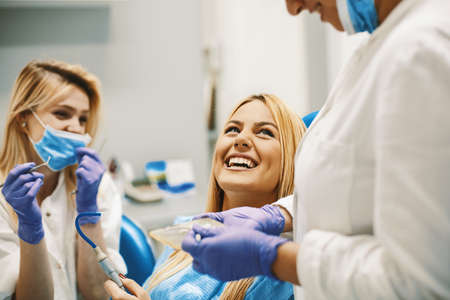 Young blonde woman at the dentist office. Stock Photo