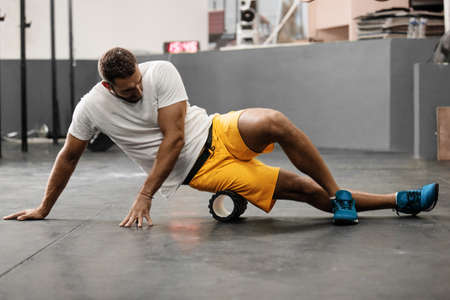 Young athlete man is preparing for training. Stock Photo