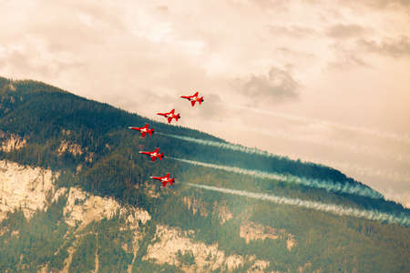A team of fighter aircraft performs team work ability in Swiss Alps.