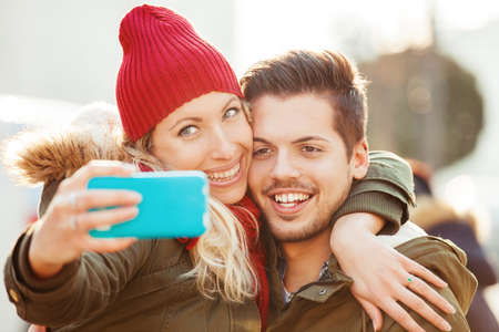Young couple in love enjoying autumn day together. Stock Photo