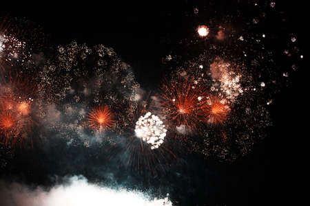 Colorful fireworks of various colors over night sky .