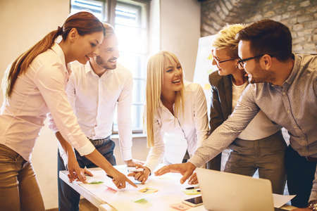 Creative business team working on project in office board room. Stock Photo