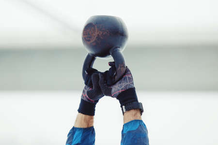 Sportive man exercising. Cold winter day.  Stock Photo