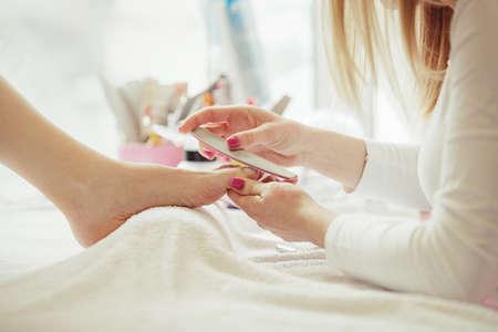 Woman feet receiving pedicure. Close up concept.  Stockfoto