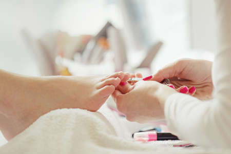 Woman feet receiving pedicure. Close up concept.  Stock fotó