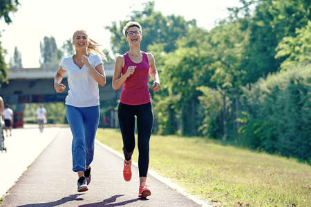 Two young woman is joging in the morning. Stock Photo