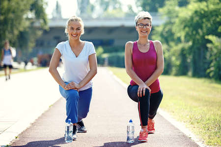 Two young woman is exercising in the morning.