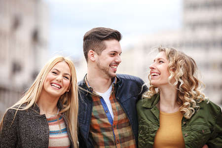 Group of young friends having fun outside. Stock Photo