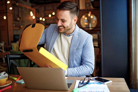 Businessman doing his freelance job in cafe. Stock Photo