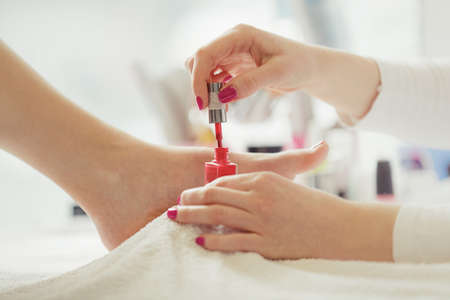 Woman feet receiving pedicure. Close up concept.  Stock Photo