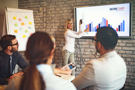 Creative business team working on project. Creative director is showing chart to the workers. Stockfoto