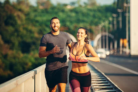 Couple is exercise on the bridge early in the morning.