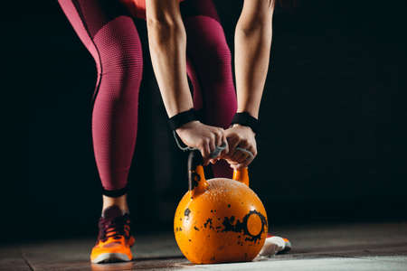 Woman is ready for fitness training with kettlebell Stockfoto - 132915997