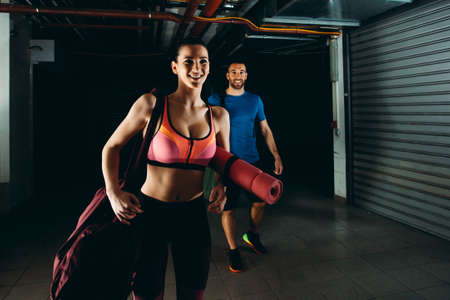 Couple is ready for fitness training in the garage.
