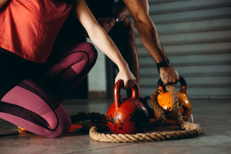 Couple is ready for fitness training in the garage. Stockfoto - 132916002