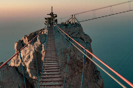 Suspension bridge over the abyss at the top of Mount Ai-Petri