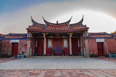 panoramic view of Lukang Wu temple front gate in winter, Taiwan. ground paved with red brick