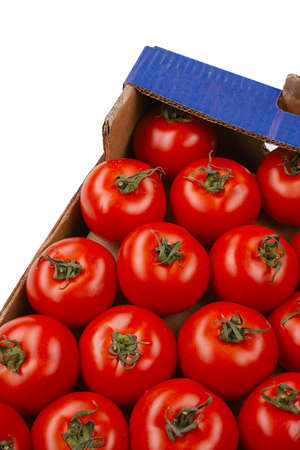 tasty tomatoes in a box isolated on white photo