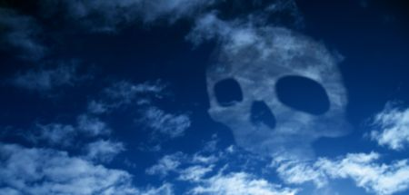 A skull in the sky, symbolizing all the co2, waste and poison, wich is released by the industrial manufactors, every day.  Stock Photo