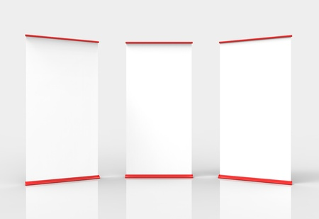 Three blank roll-up poster banner displays Stock Photo