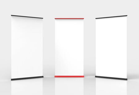 Three blank roll-up poster banner displays photo