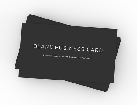 A stack of black business cards on a dark wood desktop  Easy to insert your own company information and logo