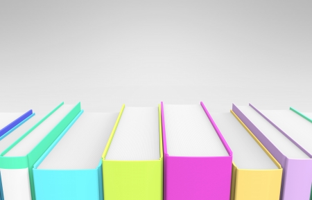 A row of very colorful books on a grey background  Stock Photo