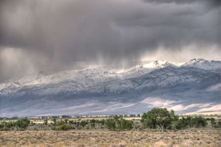 Virga rain over the mountains photo