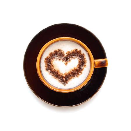 Coffee cup with chocolate heart shape photo