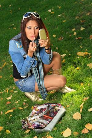 kazakh: Young beauty doing make-up