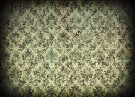 Vintage damask wallpaper with cracks and vignetting photo