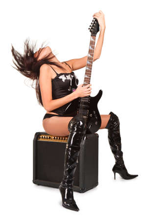 Young attractive sexy girl with rock guitar and amp Stock Photo - 4469636