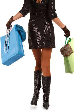 waist-down view of woman carrying shopping bag Stock Photo - 4526759