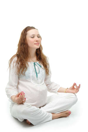 Pregnant meditating woman photo