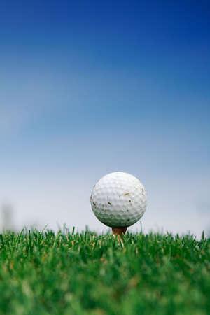 Golf ball on the grass over blue sky Stock Photo - 10042119