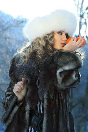 woman in fur coat: portrait of a winter carnival woman