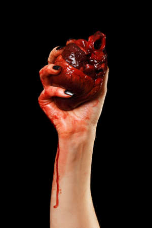 Human heart in hand isolated on black Stock Photo - 7925864