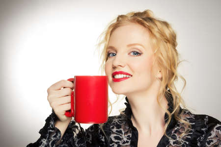 Pretty woman with a cup  photo