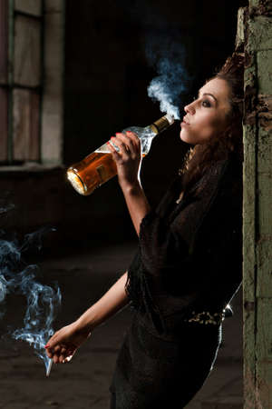 drunk girl: woman smokes in the dark room  Stock Photo