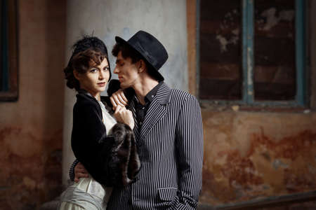 Retro styled fashion portrait of a young couple. Stock Photo - 9946945