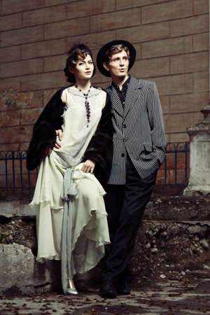 Retro styled fashion portrait of a young couple. Stock Photo - 9946915