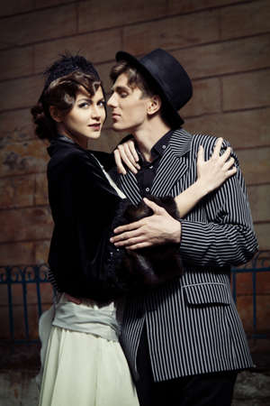 Retro styled fashion portrait of a young couple. Stock Photo - 9946867