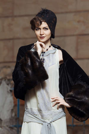 Retro styled fashion portrait of a young woman. Reklamní fotografie