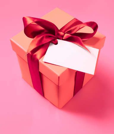 Gift box with ribbon and empty label photo
