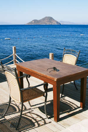chairs and table in beach cafe photo