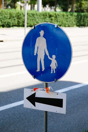 parental: Blue and white parent and child road safety sign Stock Photo